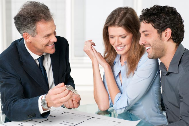 Real estate agent helping a couple buy a Florida home